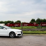 2014 Audi A7 TDI side profile with train